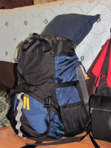 Packed daypack with pillow on top