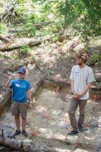 Mike and I in Housepit 7 for Public Day. I think I was describing the small size of our normal bone pieces in comparison to the elk Pelvis find. Photo Credit: Alissa