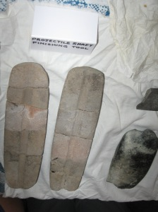Two arrow shaft shapers and an adze in the right bottom.